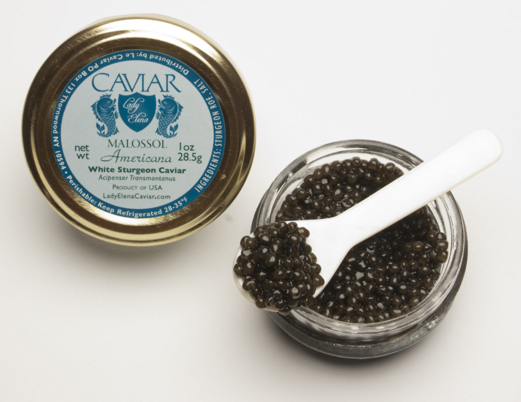 Caviar Sale White Sturgeon Caviar opened jar with spoon across